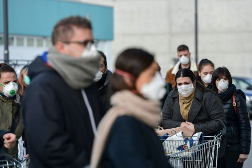 Photos show the scene inside northern Italy supermarkets as panicked shoppers stock up on supplies amid a surge of the coronavirus