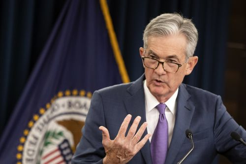 Trump lashes out after Fed chief Powell signals the central bank won't cut rates as much as White House wants