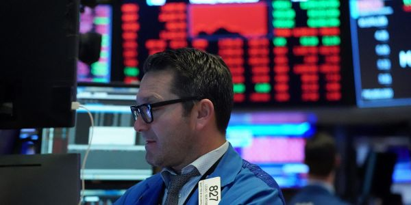 US stocks slide amid dispute over Fed funds and spiking COVID-19 cases