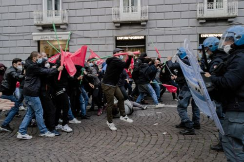Curfews, closings and police clashes: Spain and Italy impose tough new measures as COVID cases spike