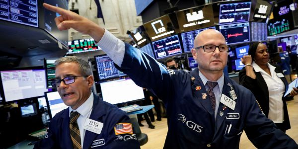 Dow soars 318 points to record high as investors weigh new economic-recovery data