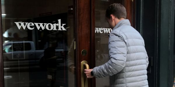 WeWork layoffs began on Monday, sources say, with one person calling it a 'small mercy'