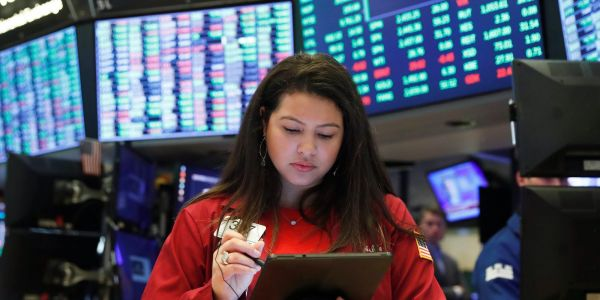 US stocks trade mixed as investors await inflation outlook from the Fed