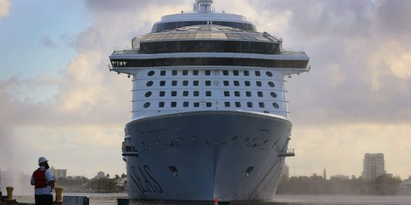 Royal Caribbean postpones cruise after 8 crew members on board test positive for COVID-19