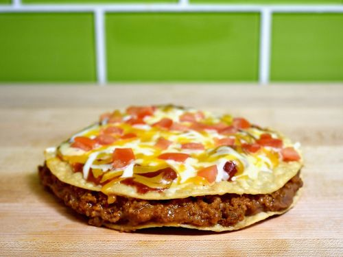 Taco Bell fans are demanding the chain bring back Mexican Pizza after announcing the return of potatoes. Here's why a top Taco Bell exec says not to give up hope