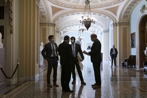 Senate works through night, virus aid on path to passage
