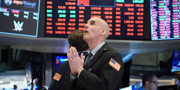US stocks erase losses, finish higher amid renewed stimulus optimism