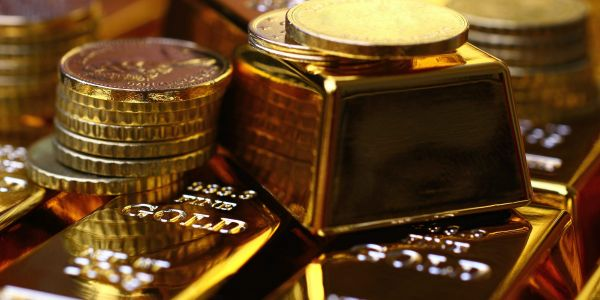 Gold slides almost 3% after the Fed hints at faster rate hikes, sending investors hunting for yield