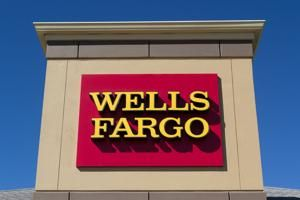 Wells Fargo details big drop in profits in first earnings report since new CEO named