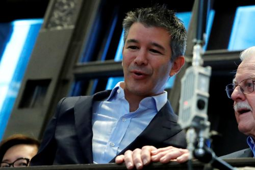 Travis Kalanick walked in to the New York Stock Exchange for Uber's IPO with his father and the crowd erupted in 'enormous applause'