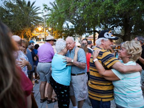 The most popular place to move to right now is a massive Florida community where residents dance in piazzas and whip around in golf carts - here's why