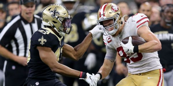49ers tight end George Kittle says he was thrilled when a defender grabbed his face mask on the biggest play of the game