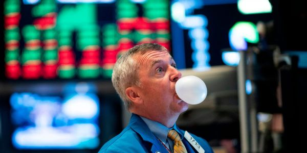 US stocks slip from record highs as investors mull weak retail-sales data ahead of Fed decision