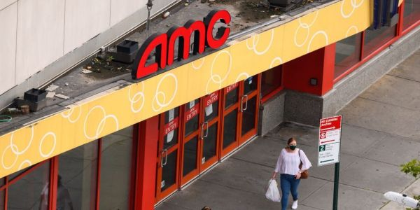 AMC theater chain plunges 14% after it warns of potential bankruptcy and says it plans to raise cash